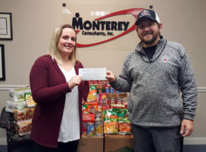 Director of Medical Records Operations Abbey Williamson gives check to the Dayton VA Food Pantry